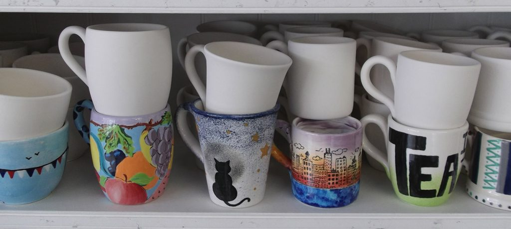 mugs in ceramic painting workshop berkshire